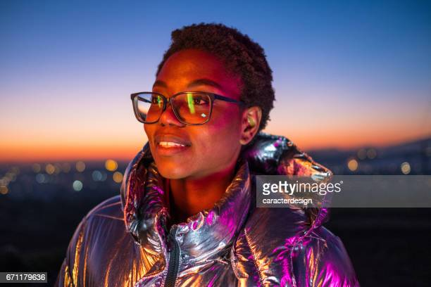 Young urban girl and city lights