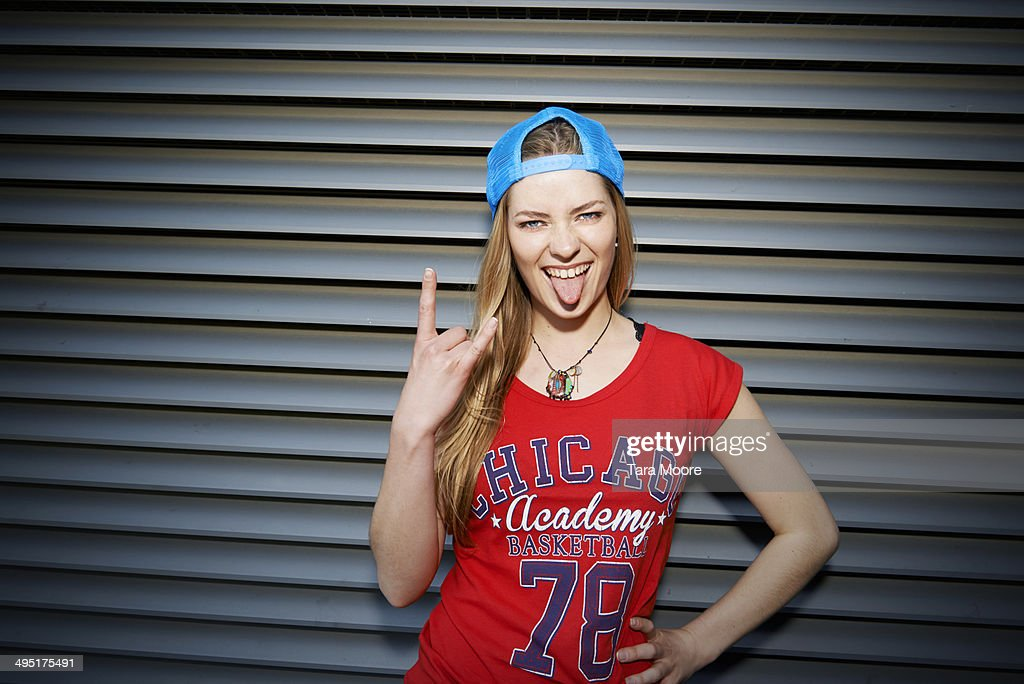 young urban woman making silly face to camera