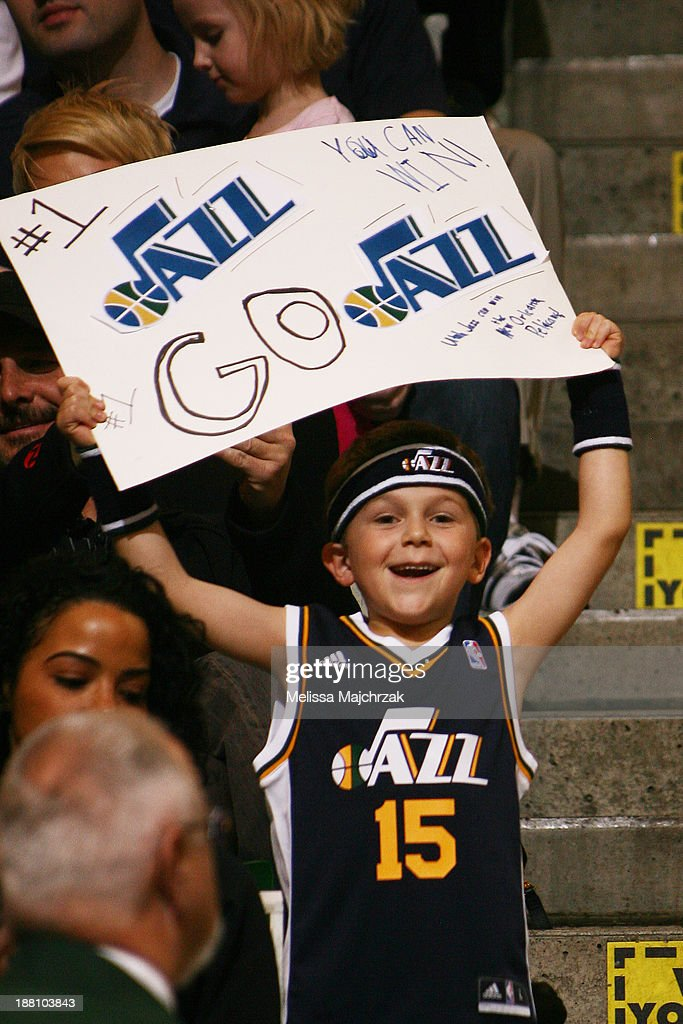 A young Utah Jazz fan cheers during the game against the New Orleans Pelicans at EnergySolutions Arena on November 13, 2013 in Salt Lake City, Utah.