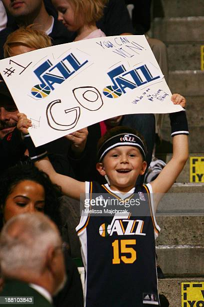 A young Utah Jazz fan cheers during the game against the New Orleans Pelicans at EnergySolutions Arena on November 13 2013 in Salt Lake City Utah...