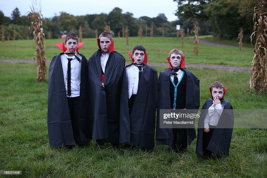 Young vampires pose for a photograph before the Shocktober Fest at Tulleys Farm on October 5, 2013 near Crawley, West Sussex. Each October thousands attend the United Kingdom's biggest Halloween themed attraction which includes six different haunted attractions and rides. The event set a new UK record for the biggest gathering of vampires, but missed out on breaking the world record.