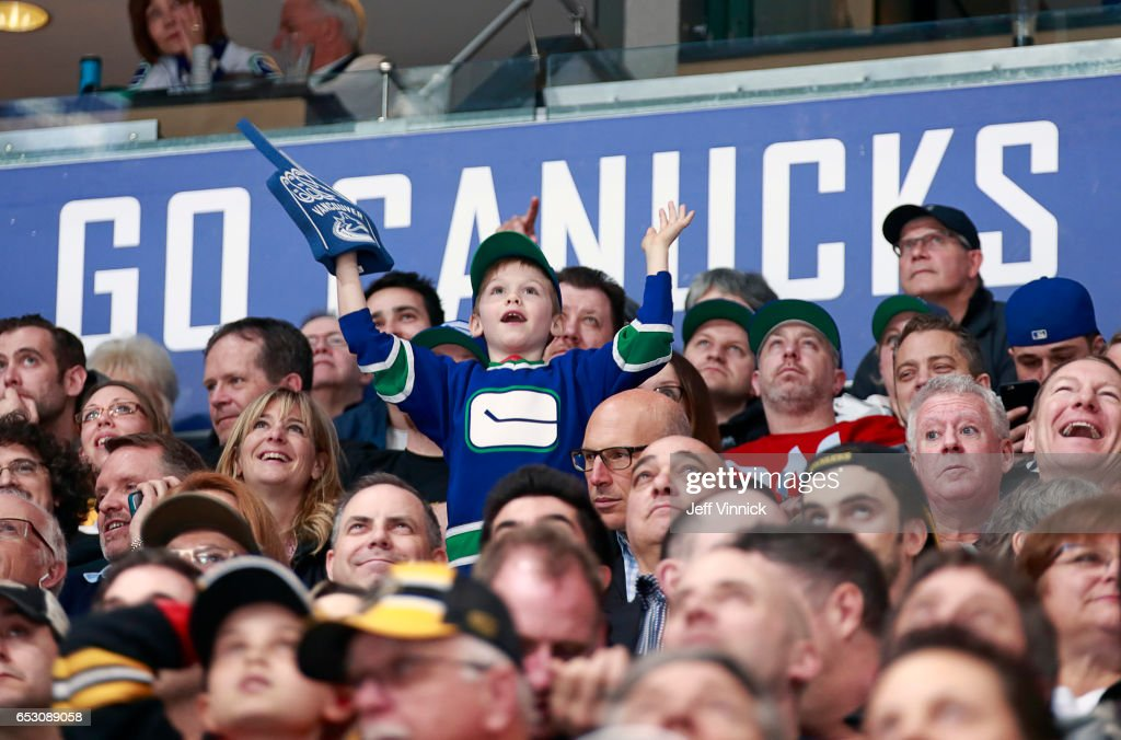 A young Vancouver Canucks fan cheers during the NHL game against the Boston Bruins at Rogers Arena March 13, 2017 in Vancouver, British Columbia, Canada. Boston won 6-3.