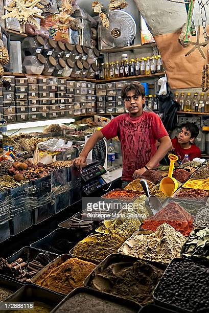 CONTENT] A young vendor in a stall during Ramadan night at AlHamidiyah Souq that is the largest and the central souk in Syria located inside the old...