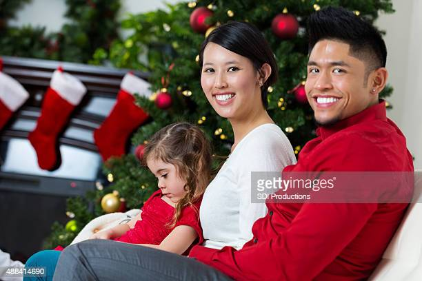 Young Vietnamese American family celebrating Christmas together
