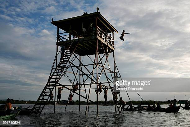 A young Vietnamese boy jumping into Tonle Sap lake They live in Kompong Luong floating village that has a large Vietnamese community and is built on...