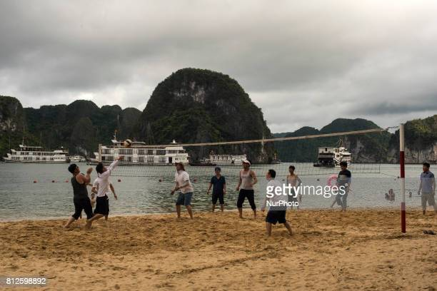 Young Vietnamese play beach volleyball on Titop Island in HaLong Bay The bay of Ha Long is an extension of water of approximately 1500 km ² Located...