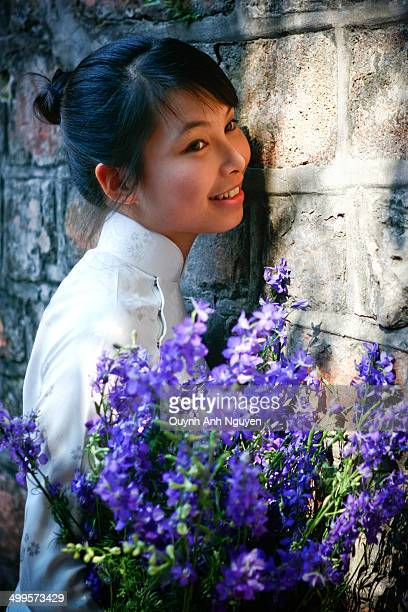 Young vietnamese woman with flower bouquet