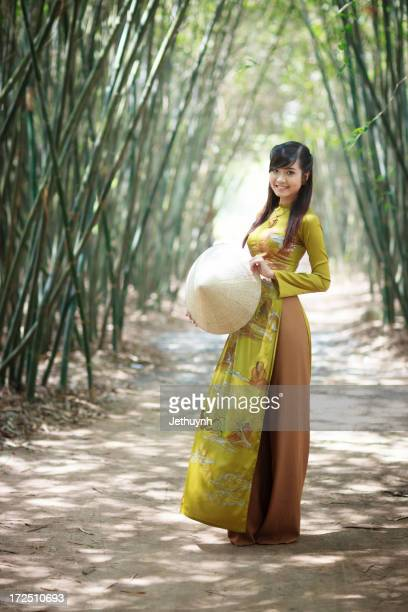 Young Vietnamese Women in Bamboo Forest