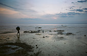A young village boy carries a bucket back to the shore after washing it in the waters of the Tapajos river at sunset The Floresta Nacional do Tapajos...