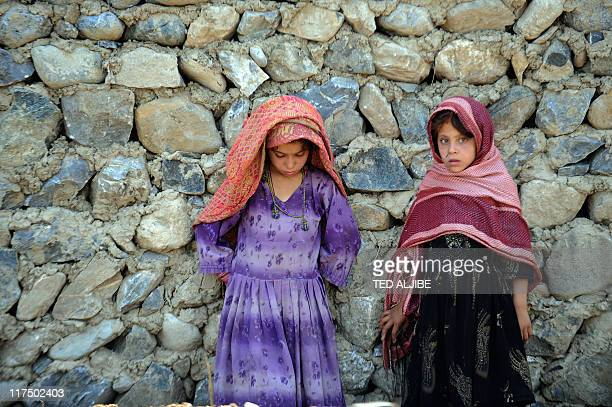 Young village girls stand next to wall in Sabari district in eastern Khost province on June 24 2011 AFP PHOTO/TED ALJIBE
