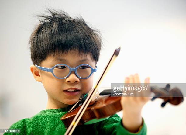 Young violin player in class.