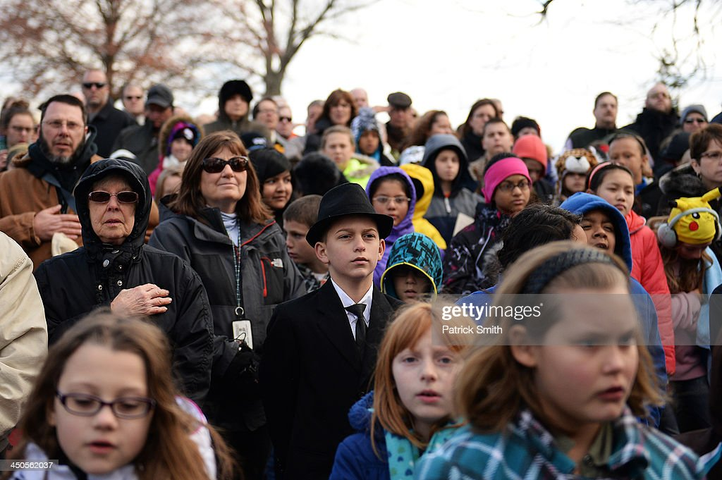 A young visitor dressed as U.S. President Abraham Lincoln listens to speakers during a commemoration of the 150th Anniversary of the Gettysburg Address at the Soldiers' National Cemetery at Gettysburg National Military Park on November 19, 2013 in Gettysburg, Pennsylvania. The iconic Gettysburg Address was given by U.S. President Abraham Lincoln in 1863 during the Civil War and highlighted the principles of democracy, human equality, and freedom and professed that 'government of the people, by the people, for the people, shall not perish from the earth.'.