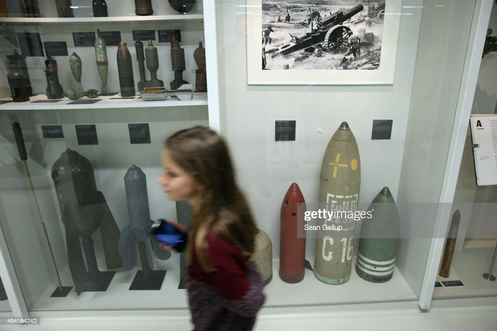 A young visitor walks past an exhibit of artillery and mortar shells used by the Germans and the French during World War I at the Museum of the Great War at Meaux (Musee de la Grande Guerre du Pays de Meaux) on August 25, 2014 in Meaux, France. At the beginning of September, 1914, German armies had nearly reached Paris when British and French armies, after weeks of retreat, counterattacked and stemmed the German advance in the First Battle of the Marne, pushing the Germans north to what would soon become the stalemate trench war that defined the Western Front for the next four years.