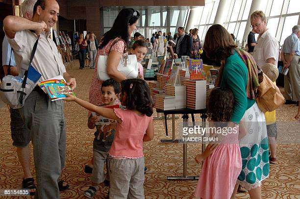Young visitors and their parents browse through the books and comics on display at the International Festival of Literature in Dubai on February 28...