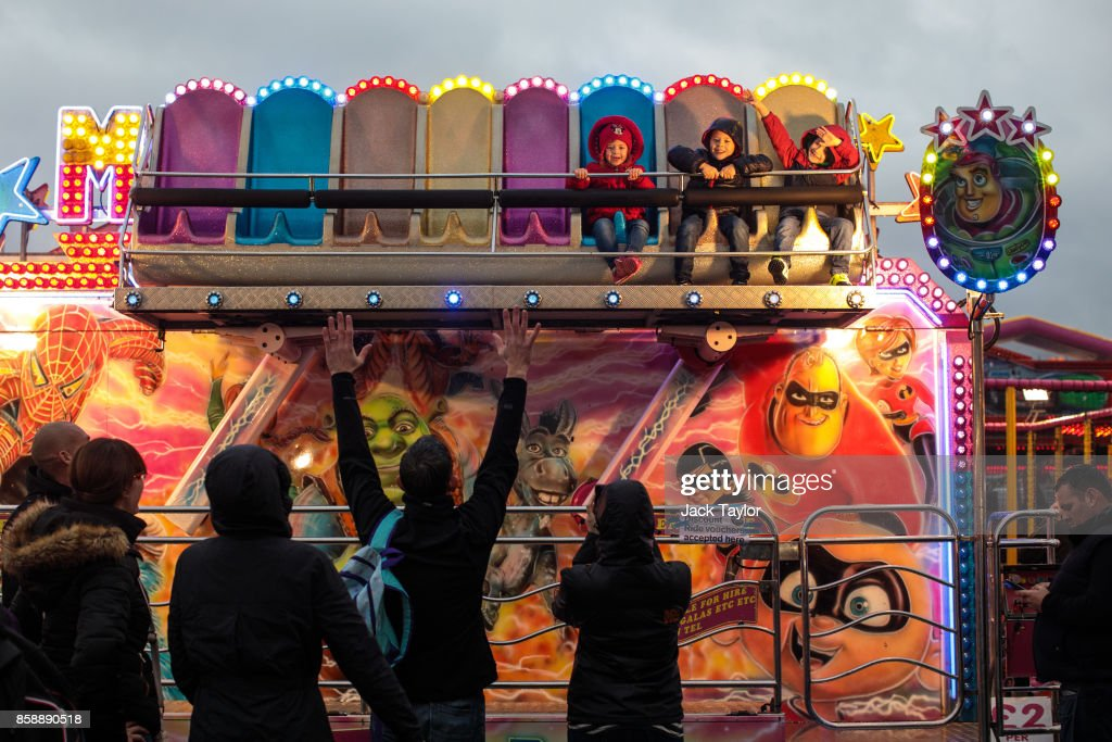 Young visitors enjoy a ride at the Nottingham Goose Fair in the Forest Recreation Ground on October 7, 2017 in Nottingham, England. The annual goose fair hosts over 500 attractions for thrill seekers including fun fair classics such as bumper cars, carousels and helter-skelters. The fair is thought to be over 700 years old and its name comes from its origins as a market in the forest grounds where thousands of geese were sold each year.
