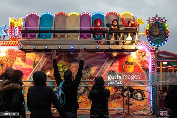Young visitors enjoy a ride at the Nottingham Goose Fair in the Forest Recreation Ground on October 7 2017 in Nottingham England The annual goose...