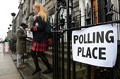 A young voter leaves a polling station after casting her vote in Edinburgh Scotland on September 18 during a referendum on Scotland's independence...