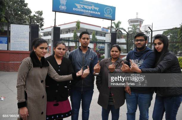Young voters showing their fingers after casting their votes on February 4 2017 in Jalandhar India Punjab on Saturday voted in its first and only...