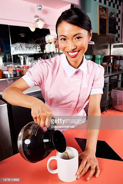 Young waitress invites you to coffee in a 50s diner