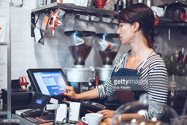 Young waitress is taking order