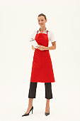 Young waitress writing order on notepad, smiling, portrait