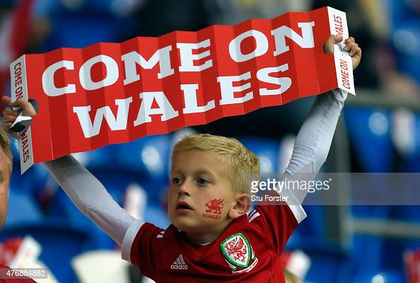 A young Wales fan shows his support before the UEFA EURO Group B 2016 Qualifier between Wales and Belguim at Cardiff City stadium on June 12 2015 in...