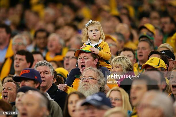 A young Wallabies fan looks on as the Australian national anthem is played during The Rugby Championship Bledisloe Cup match between the Australian...