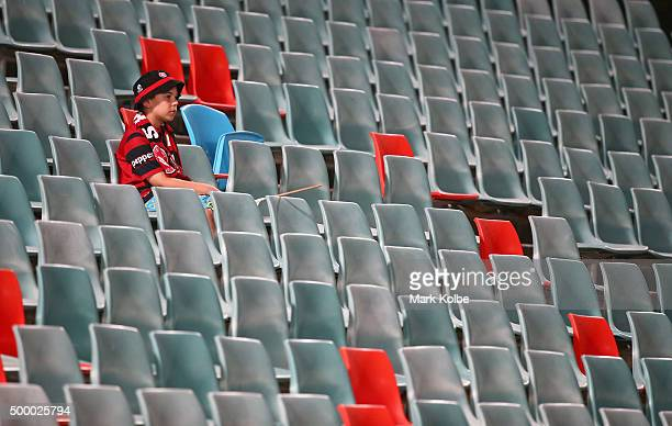 A young Wanderers supporter watches on from the empty seats in the bays usually taken up by 'Red and Black Bloc' Wanderers supporters groupduring the...