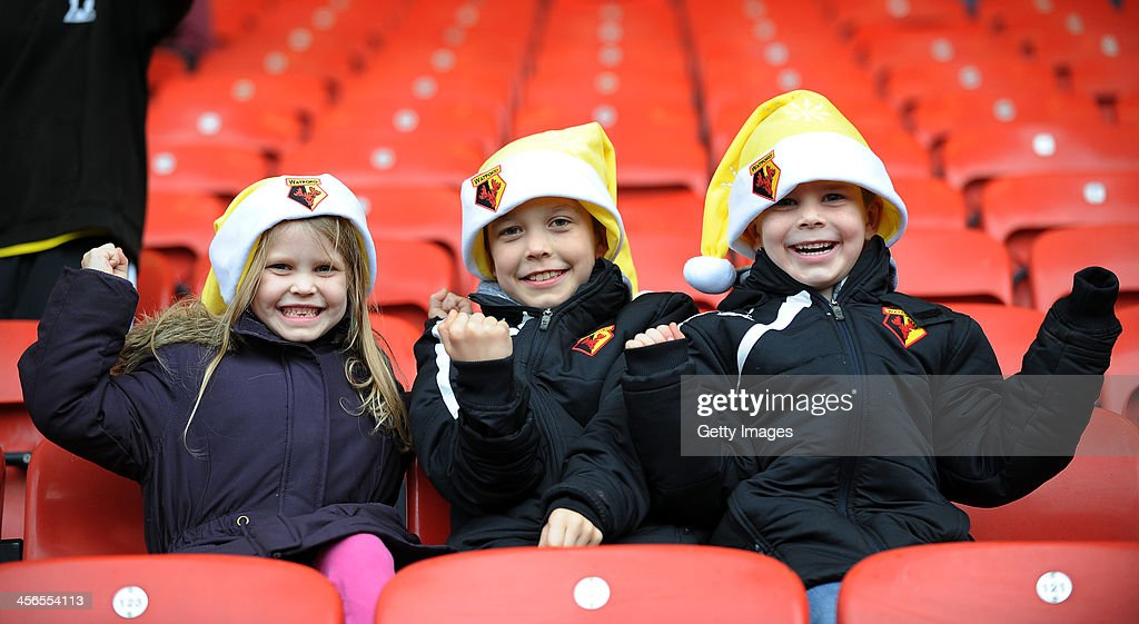 Young Watford fans are seen prior to the Sky Bet Championship match between Watford and Sheffield Wednesday at Vicarage Road on December 14, 2013 in Watford, England,