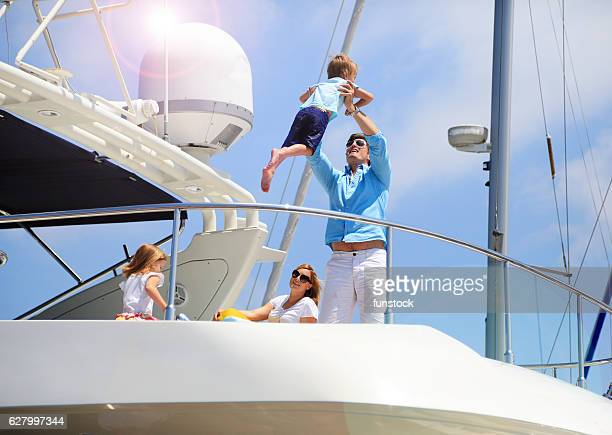 Young wealthy family enjoying summer vacation