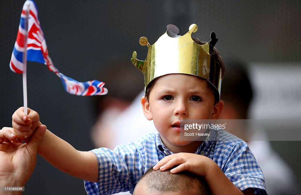 A young well wisher waits outside The Lindo Wing as he awaits Catherine, Duchess Of Cambridge and her newborn son at on July 23, 2013 in London, England. The Duchess of Cambridge yesterday gave birth to a boy at 16.24 BST and weighing 8lb 6oz, with Prince William at her side. The baby, as yet unnamed, is third in line to the throne and becomes the Prince of Cambridge.