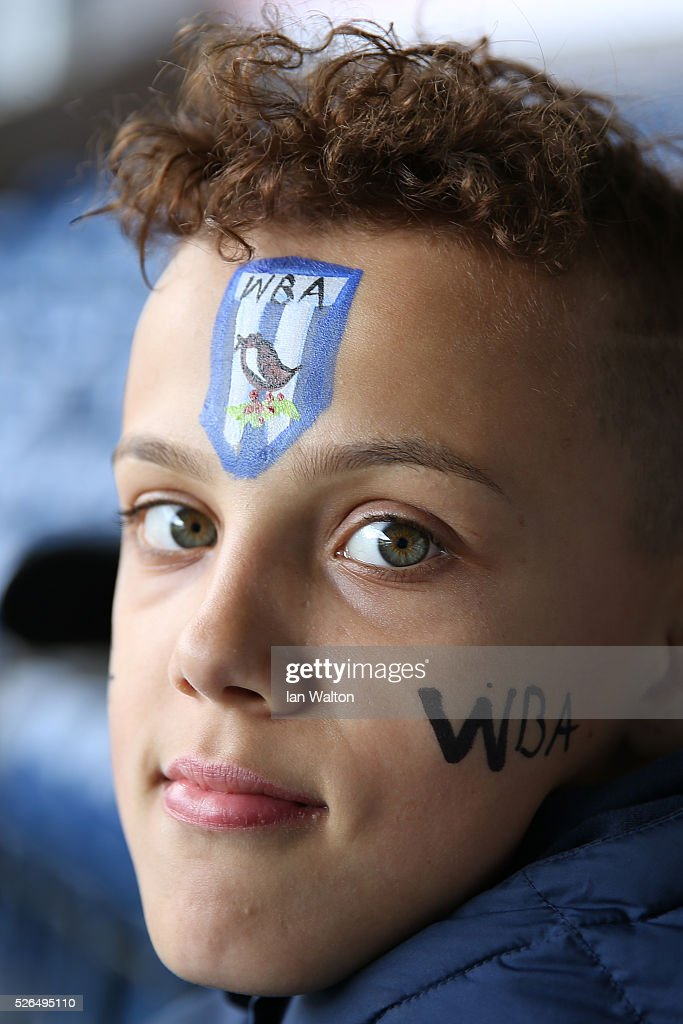 A young West Bromwich Albion supporter is seen prior to the Barclays Premier League match between West Bromwich Albion and West Ham United at The Hawthorns on April 30, 2016 in West Bromwich, England.