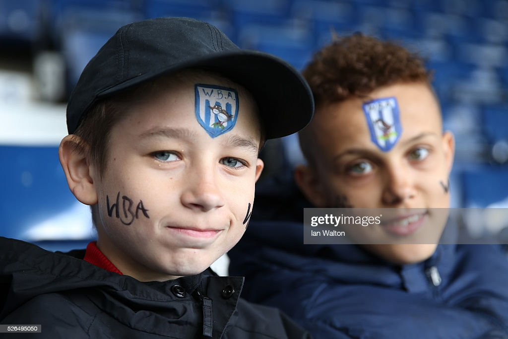 Young West Bromwich Albion supporters are seen prior to the Barclays Premier League match between West Bromwich Albion and West Ham United at The Hawthorns on April 30, 2016 in West Bromwich, England.