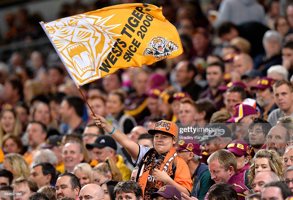 A young Wests Tigers fan shows her support during the round 12 NRL match between the Brisbane Broncos and the Wests Tigers at Suncorp Stadium on May 27, 2016 in Brisbane, Australia.