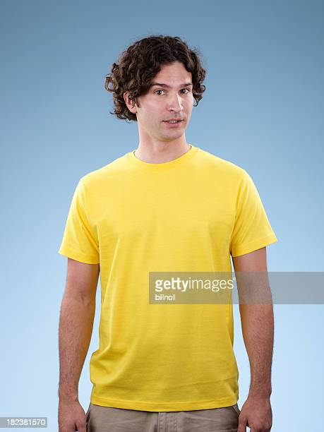 Young white male wearing yellow shirt