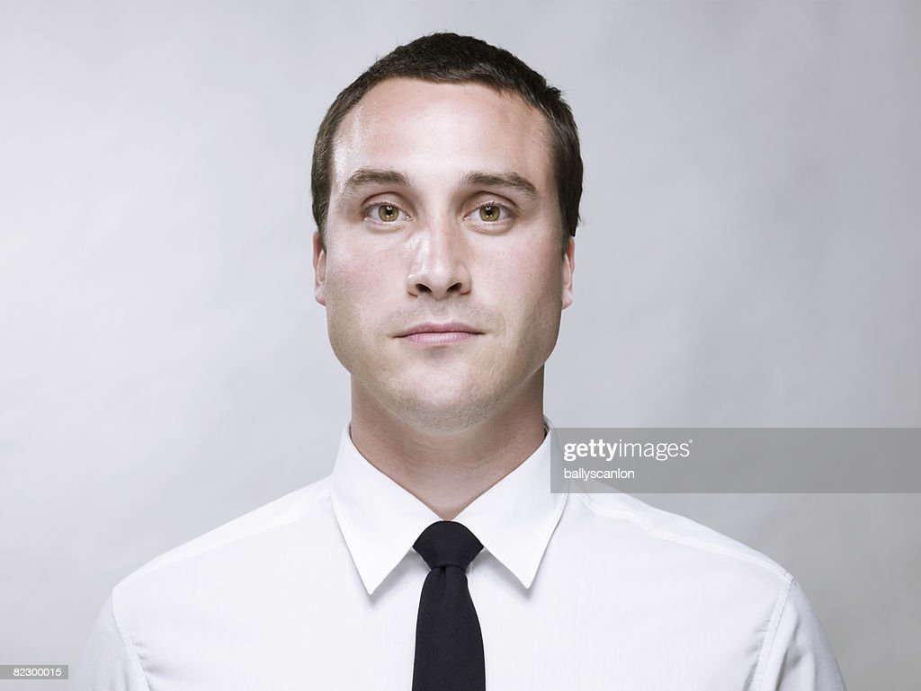Young white man wearing a white shirt and tie  : Stock Photo