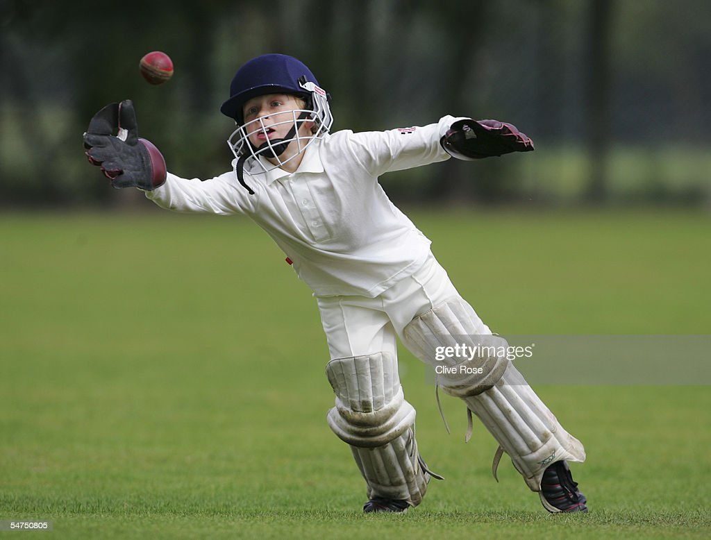A young wicketkeeper dives for the ball at The Spencer Club on August 14 2005 in London