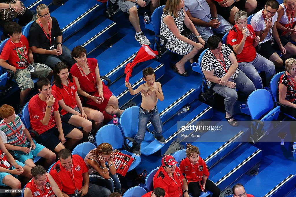A young Wildcats supporter swings his shirt in the air during the round 20 NBL match between the Perth Wildcats and the Melbourne Tigers at Perth Arena on February 21, 2013 in Perth, Australia.