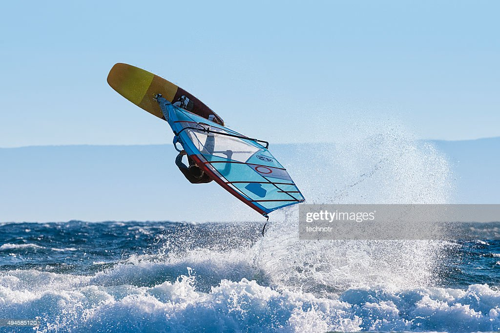 Young Windsurfer Jumping Wave on Windsurf Board : Stock Photo