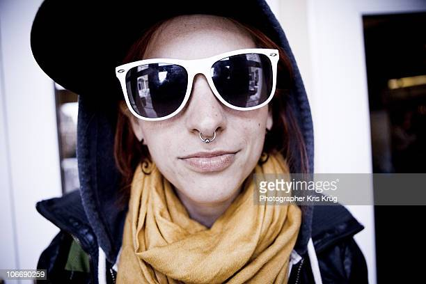 Young Woma Wearing Large Sunglasses, Scarf and Hat