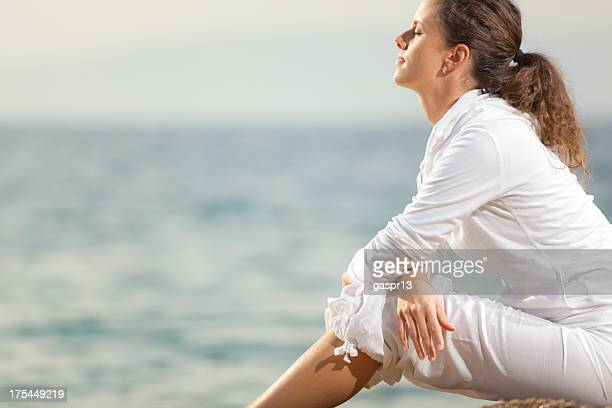 young woman absorbed in thought