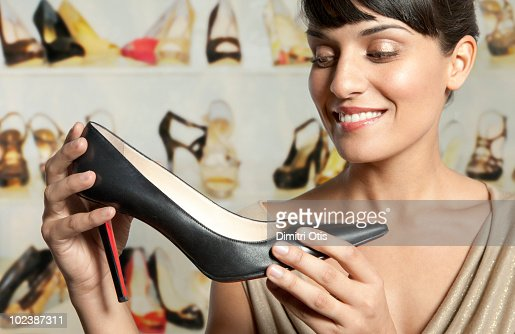 Young woman admiring shoe : Stock Photo