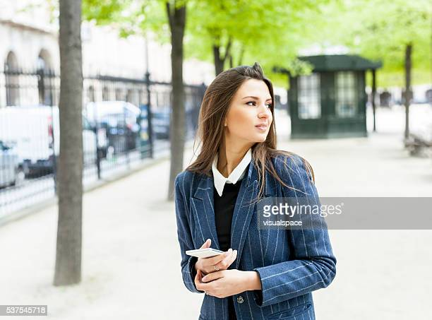 Young Woman Admiring The View Of A Park Outdoors