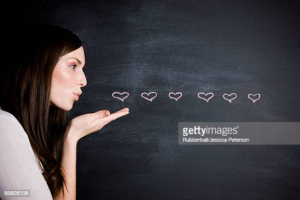 young woman against a chalkboard