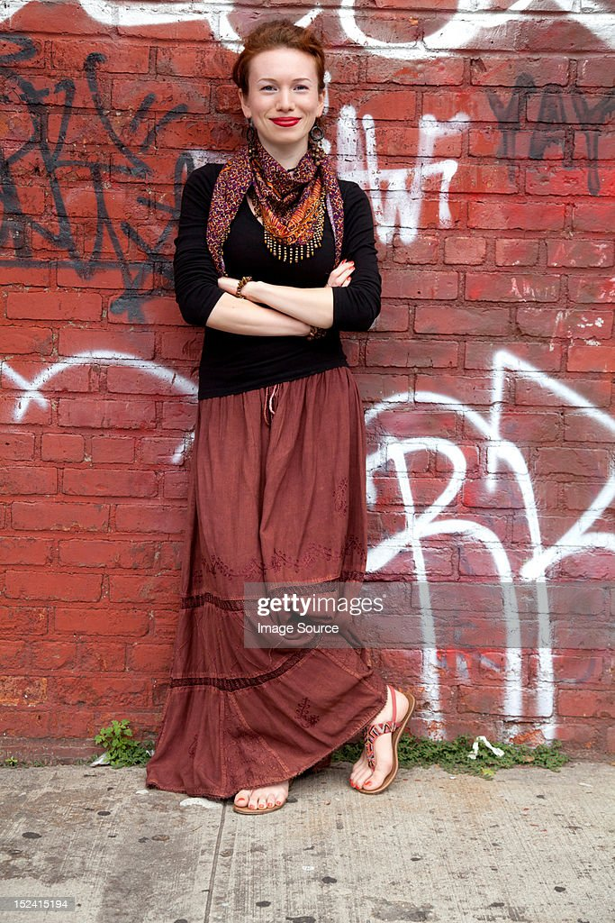Young woman against wall of graffiti