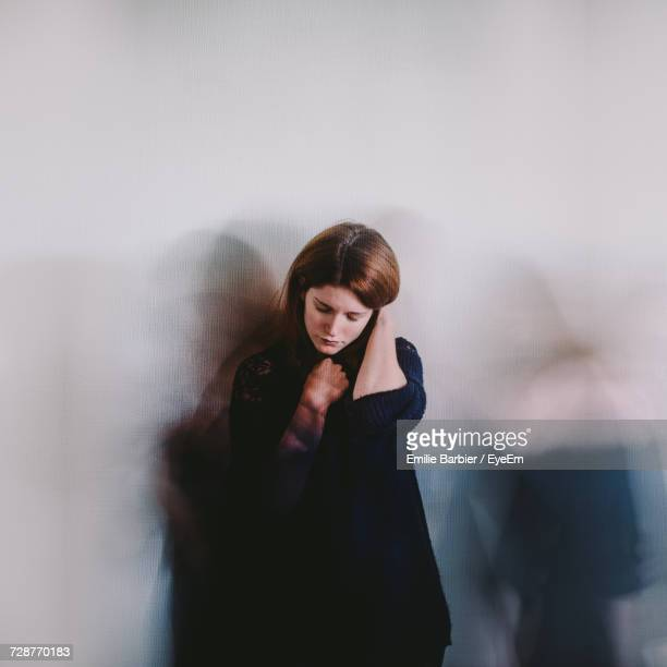 Young Woman Against Wall