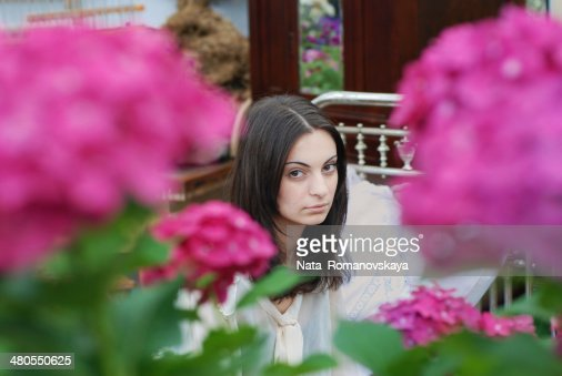 Young Woman among Flowers : Stock Photo