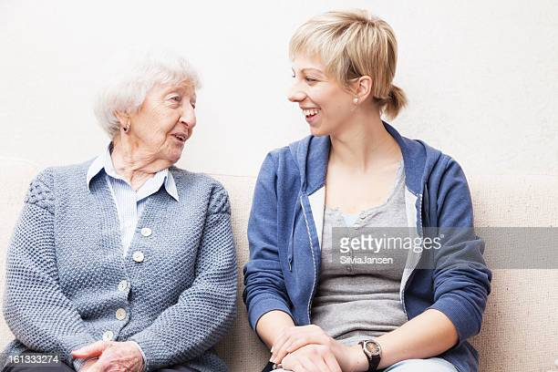Young woman and a senior woman smiling and talking