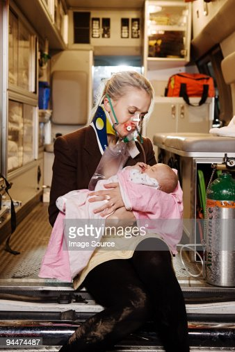 Young woman and baby in ambulance : Stock Photo