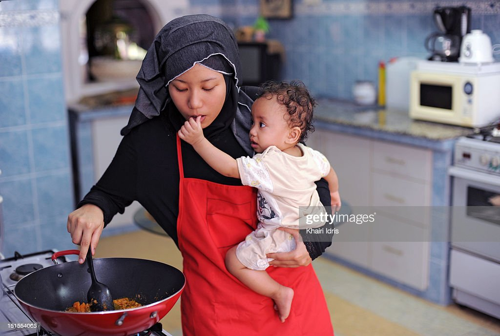 Young woman and baby : Stock Photo